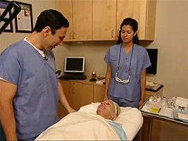 Dr. Simon Ourian examining his patient